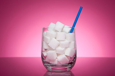 Research recommends halving recommended sugar intake